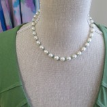 Pearls and emerald necklace close