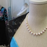 Pearls and ruby necklace close